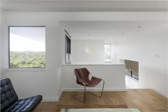"""""""When you look out of the windows from the upper level you see trees for miles. You wouldn't think you are in Texas, at least out-of-towners wouldn't, or near a major city,"""" Arbib said. The upstairs living room features a Paulistano Armchair by Paulo Mendes da Rocha nearest the entryway, and a Barcelona chair by Ludwig Mies van der Rohe next to the window."""