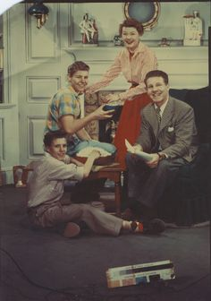 Ozzie and Harriet Nelson (from The Adventures of Ozzie and Harriet) enjoying JOLLY TIME popcorn with their sons