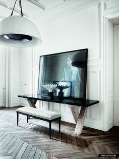 large photo, large light fixture, wood floor automatism: Cool and Elegant