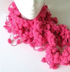 Every female needs a boa!!! Little soft pink puffs make this scarf or boa a…
