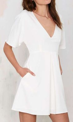 The Nasty Gal Carrie Pleated Dress is the LWD you've been looking for! This structured ivory number will put an end to your perfect party dress stress. Fit And Flare Cocktail Dress, V Neck Cocktail Dress, Fit Flare Dress, Low V Neck Dress, Wedding Dress With Pockets, Dress Pockets, Minimal Outfit, Little White Dresses, White Fashion