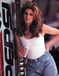 The supermodel strikes a pose in hip hugging high-waisted denim over a white bodysuit during this iconic Pepsi Super Bowl commercial. Cindy Crawford Pepsi, Cindy Crawford Photo, Looks Hip Hop, 90s Fashion, Fashion Outfits, Jeans Levi's, 90s Hairstyles, Aesthetic Fashion, Urban Aesthetic
