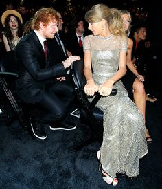 2014 grammy's Taylor Swift turned around in her seat to talk to pal Ed Sheeran during the show