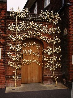 Gold leaves around Hampton Court Palace door, Middlesex, UK by tezzer57, via Flickr