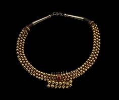 Indian, Necklace, 19th century, gold, ruby, and cloth cord.