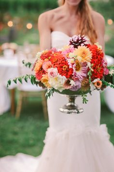 gorgeous late summer inspired centerpiece. #summerflowers #centerpiece #gardenwedding http://www.weddingchicks.com/2013/12/06/love-letter-wedding/