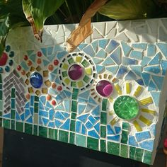 I like how the jewels serve as centers for the flowers. Mosaic Bottles, Mosaic Pots, Mosaic Wall, Mosaic Glass, Mosaic Art Projects, Mosaic Stepping Stones, Mosaic Flowers, Principles Of Design, Tiling