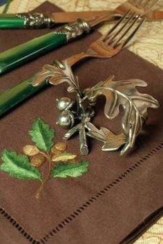 Acorn Napkin Rings along with wonderful embroidered napkins and green flatware