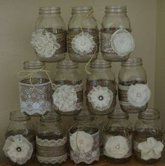 For sale is 12 handmade mason jar sleeves. Burlap adorned with lace and handmade ivory flowers are perfect for a rustic wedding! Lace is ivory, also. Mason jars are not included. These will fit Ball quart regular mouth. I can do other size sleeves. Please do not hesitate to message