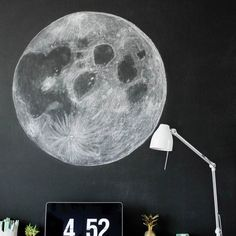 Have a chalkboard? Make this amazing moon chalk art! It's easier than it looks!