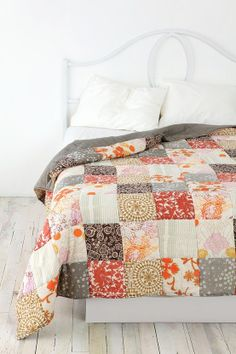 These colours make me happy. Quilted bed cover in natural pinks and browns.