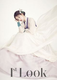 'Suzy' was seen wearing a Hanbok in pictures. First Look featured 'Suzy' in a Hanbok.