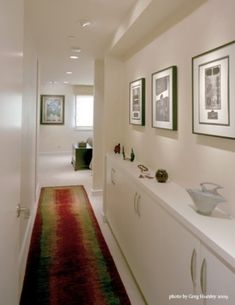 Shallow built in cupboards in a narrow hallway make the most of every inch