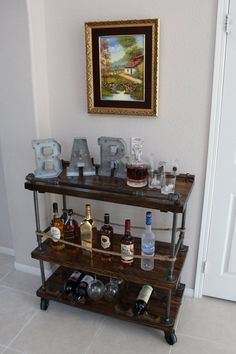 This beautiful, handmade, solid wood and steel bar cart is the furniture piece that will set your house apart! Featuring 3 levels of solid wood linked together by black pipe the cart is both usable and display worthy! The bottom level holds 4 wine bottles & 6 wine glasses; the middle level holds your bottles of liquor or more bottles of wine as well as features our unique rustic bottle opener; upper level features push handle and towel rack. Customizeable options available as well such as...