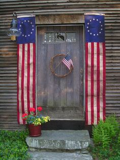 Will use red, white and blue bunting beside door, Something else for the grapevine wreath.