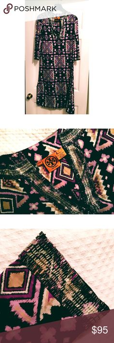 "Tory Burch Beaded Ikat Beach Tunic Stunning coot on voile beach tunic with side vents and slash collar trimmed in 1-3/4"" of shimmery bugle beads at neckline and wrists.  Neck opening has hook & eye closure.  Sophisticated Ikat pattern has chocolate base with lilac, egg plant, taupe & white design.  Can be worn to beach, pool and into evening in a tropical setting.  Be aware that cotton is not opaque.  Length from nape of neck to hem is 48"" Tory Burch Swim Coverups"