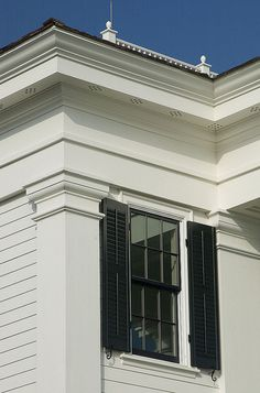 Corner Pilaster - Chadsworth Cottage A corner pilaster supports a custom entablature. The window and its shutter fits perfectly between the pilasters.