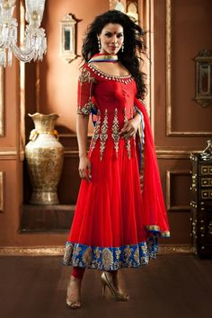Bollywood style red anarkali suit - Red color anarkali suit is crafted on net material. Cotton silk yoke and sleeves portion embellished with thread, stone and zardosi work in attractive pattern enhance the overall look.