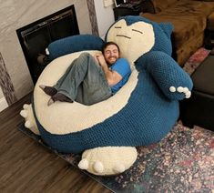 Experience ultimate comfort by taking a nap on this giant Snorlax hand knit bean bag. The giant Pokemon comes to life to bring you ultimate comfort with his inviting, ample, cozy, and soft belly that'll cradle you as you slumber. Giant Snorlax, Pokemon Snorlax, Snorlax Bed, Puff Gigante, Large Bean Bags, Room Deco, Eames, Take A Nap, Upholstered Chairs