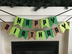 "**Please read footnotes regarding shipping and processing before ordering** This Minecraft Happy Birthday banner with black letters is the perfect addition for any birthday party! It is handmade from high quality, acid free card stock. Each flag is 4.5"" wide x 5.5"" tall with 2.5"" black cardstock letters. Colors used- Tan, Green, Bright Green and Black Hangs on black satin ribbon. Each word hangs on its own piece of ribbon as shown above. Happy hangs at approximately 24"" long on a 48"" pie..."