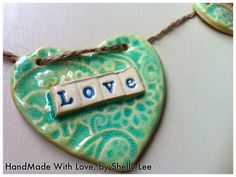 Ceramic 'Love Is All You Need' Bunting, Hanging. £15.00