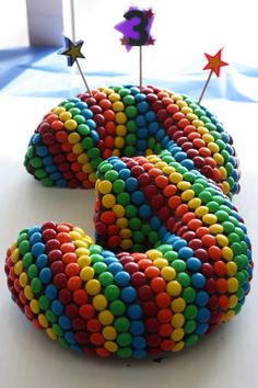 Easy cake using 2 bundt cakes, chocolate frosting and m & ms