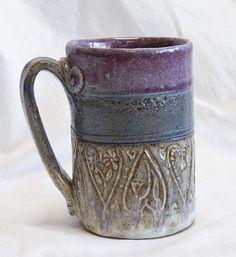 stoneware heart mug...would prefer butterflies, dragonflies, peace signs or moon/sun/stars instead.