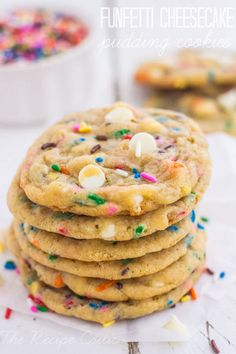 Funfetti Cheesecake Pudding Cookies at http://therecipecritic.com  AMAZINGLY soft and chewy cheesecake pudding cookies with added sprinkles and white chocolate.  These might just be the best cookie you will eat!