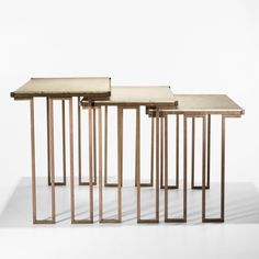 Jean Royère, Gilt Bronze and Travertine Nesting Tables, 1965.