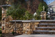 The lamppost cap is Caledonia - polished apex/flat top with a rock faced edge. Caledonia steps/treads are thermal top and rock face edge. Caledonia pavers are all thermal top.