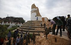 Volunteers work to remove debris at the historic Dharahara tower, a city landmark, after an earthquake in Kathmandu, Nepal, Saturday, April 25, 2015. (Photo by Niranjan Shrestha/AP Photo)