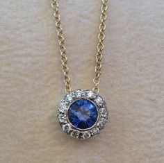 Cluster bezel pendant with blue sapphire and diamonds, one of Jane's original designs!
