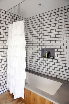 subway tile with dark grout and a frilled shower curtain // via Design*Sponge White Subway Tile Bathroom, Shower Remodel, Home, Modern Bathroom, Modern Bathroom Trends, Ruffle Shower Curtains, White Subway Tile, Bathrooms Remodel, Bathroom Design