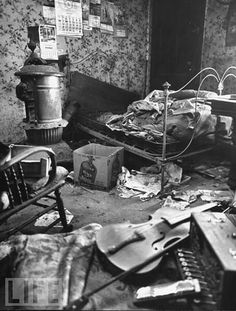 tedbunny:  The interior of serial killer Ed Gein's bedroom. Gein is thought to have murdered two people, and had filled his home with a variety of items made from the body parts of numerous corpses, which he had acquired through grave-robbing.