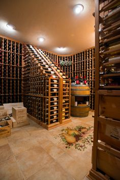 """Morrison & Kitchen & Bath also offers custom designed wine cellars. We will construct a complete """"climate controlled"""" room using the finest refrigeration and humidity control systems. Numerous storage and display options are available including single and double deep racks. Bottle storage is constructed from odorless """"All-Heart"""" Redwood, or choose from seven other wood types. Many other unique features include testing tables, custom etched glass entry doors, rolling ladders, and more."""