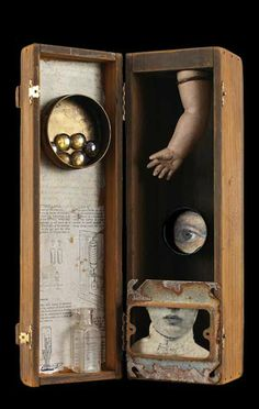Kass Copeland | Mixed Media Assemblage - Wine box, doll arm, electrical metal frame, mint box, bottle, glass beads.