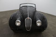 1956 Jaguar XK140 Drop Head Coupe, factory overdrive, matching numbers block, black with red interior, Drop Head coupes for restoration are becoming very hard to find, this would make an excellent car to restore. For $54,500  If you have any additional questions Please call 310-975-0272
