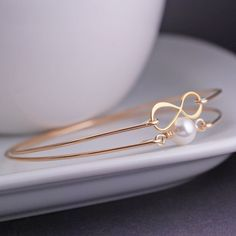 Gold Infinity and Pearl Bangle Bracelet Set  by georgiedesigns