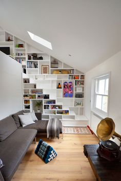 [camden loft] Interesting combo of shelving that turn into stairs that go up to…