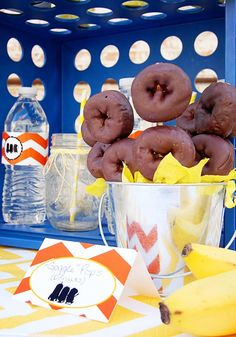 CUTE idea! Minion goggle doughnuts! Despicable Me Minion Playdate Party via Kara's Party Ideas #minions #Playdate #DespicableMe #PartyIdea #PartyDecorations #goggles #dessert #food #doughnuts