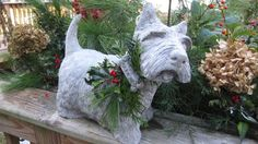 Hand Crafted in Our New England Studio. This is a statue of our Large Scottish Terrier( Scotty). It has Live Greens with jute rope and a little