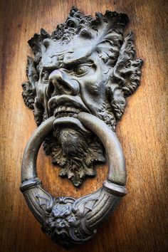 "Devil Head Door Knocker Photograph by Paolo Modena - Tuscany  ~ Somebody's knockin' ~   http://www.youtube.com/watch?v=6et5SSKUtwE  ♪♫•*¨*•.¸¸♥¸¸.•*¨*•♫♪ ~Terri Gibbs (Teresa Fay ""Terri"" Gibbs (born June 15, 1954) is an American country music artist who was born blind.)  ~Somebody's knocking, Should I let him in? Lord, it's the devil! Would you look at him? I heard about him but I never dreamed, he had blue eyes and blue jeans.♪♫•*¨*•.¸¸♥¸¸.•*¨*•♫♪"