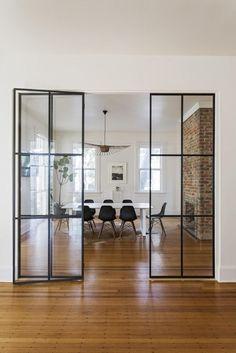 Steel-frame glass doors in historic Charleston home.
