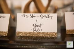 Glittery gold placecards for a wedding