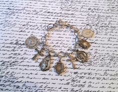 Religious Medals and Cross Bracelet Upcycled by SadiesSnippets, $45.00