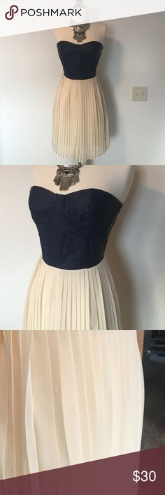 "Pleated faux leather dress Faux leather bustier style navy top with cream pleated bottom. Exposed back zip. Tiny little spot on 3rd pic - barely noticeable. 28"" length Sugarlips Dresses Strapless"