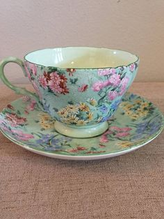 "Vintage China Shelley Tea Cup and Saucer Melody Green Floral Bone China - This is a unique and pretty Shelley fine bone china tea cup and saucer made in England. It is ""Melody"""