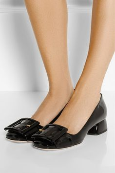 Heel measures approximately 35mm/ 1.5 inches Black patent-leather Slip on