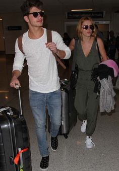 Bella Thorne's boyfriend Gregg Sulkin leads the way as they make their way out of Los Angeles International Airport (LAX) on February 16, 2016