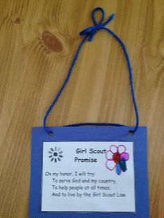 Girl scout promise door hanger.  The girls glued the promise to a piece of construction paper that had holes punched in it.  Then yarn was used to make the door hanger.  The girls are supposed to hang the promise on their bedroom door and are supposed to recite the promise every time they walk through the doorway.  Practice makes permanent!